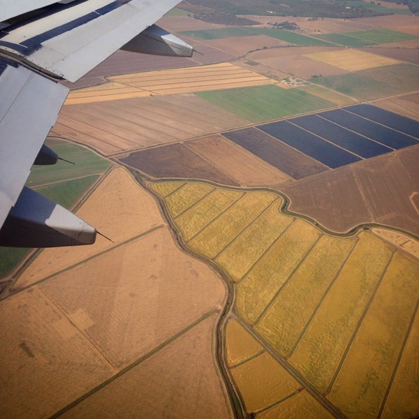 view of fields from an airplane