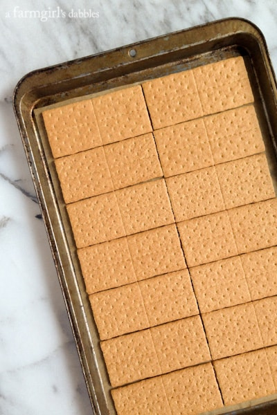 graham crackers lined up on a baking sheet