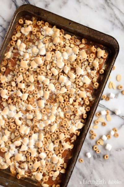 a pan of caramel Cheerios Squares