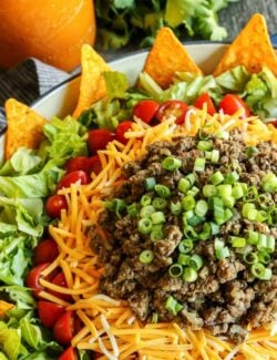 salad with taco ingredients layered on top