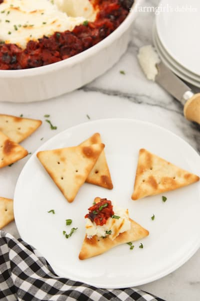 Baked Goat Cheese dip spread on a cracker