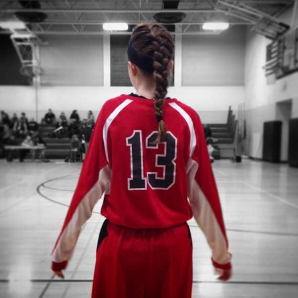 a girl in a basketball uniform