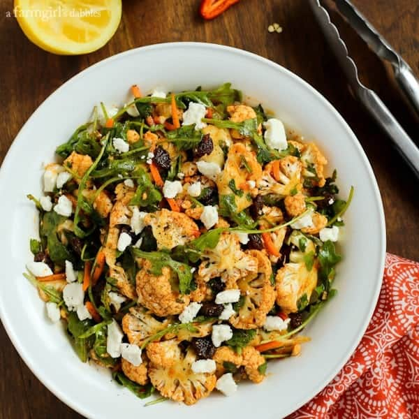 North African Cauliflower Salad with Charmoula Dressing in a white bowl