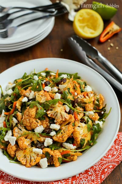 North African Cauliflower Salad topped with charmoula dressing, feta and raisins