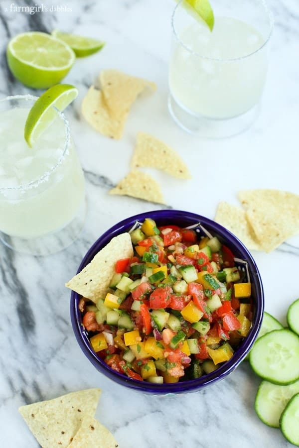 a bowl of Cucumber Pico de Gallo with tortilla chips and margaritas