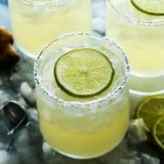 glasses of prosecco margaritas with fresh lime slices