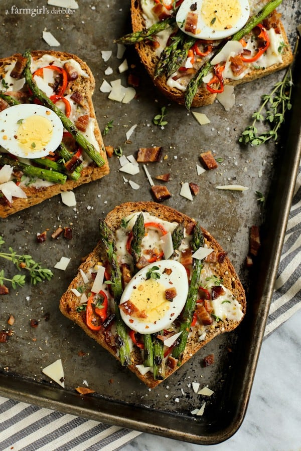 three pieces of Toast with Bacon, asparagus, red pepper, and Egg