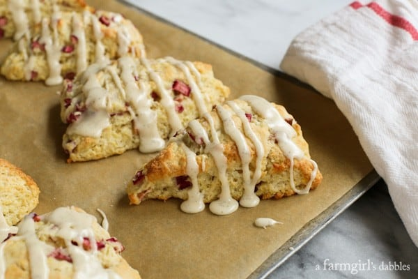 Side view of Lemon Rhubarb Scones with a dripping vanilla glaze