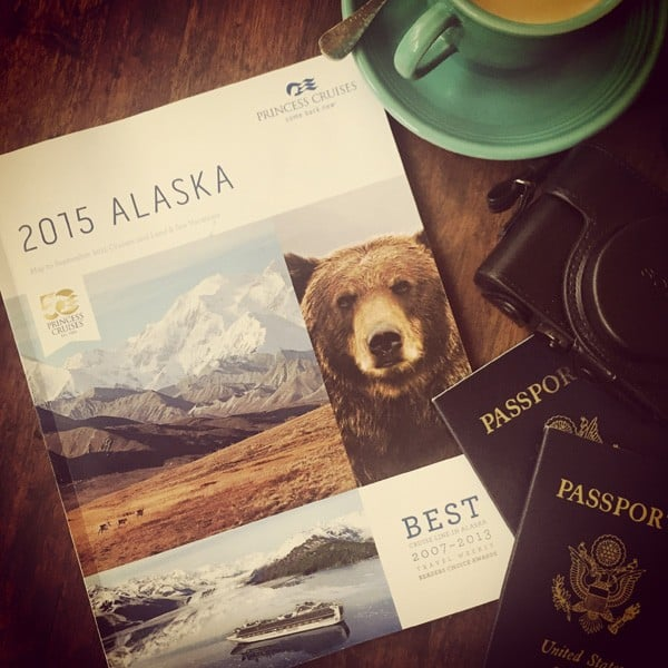 alaska travel guide with two U.S. passports