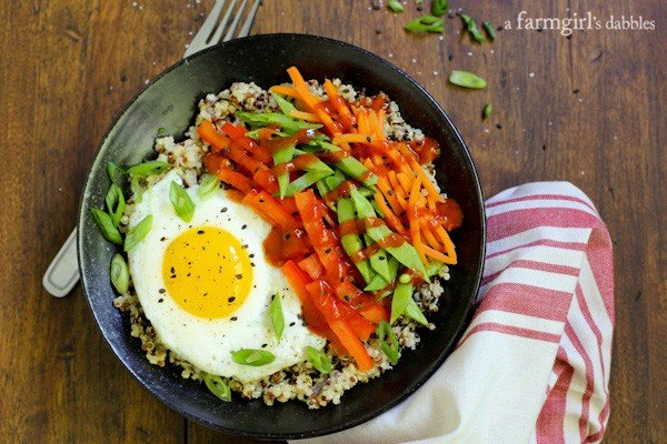 Lemon Quinoa and Egg Bowls with Veggies and Sriracha from afarmgirlsdabbles.com