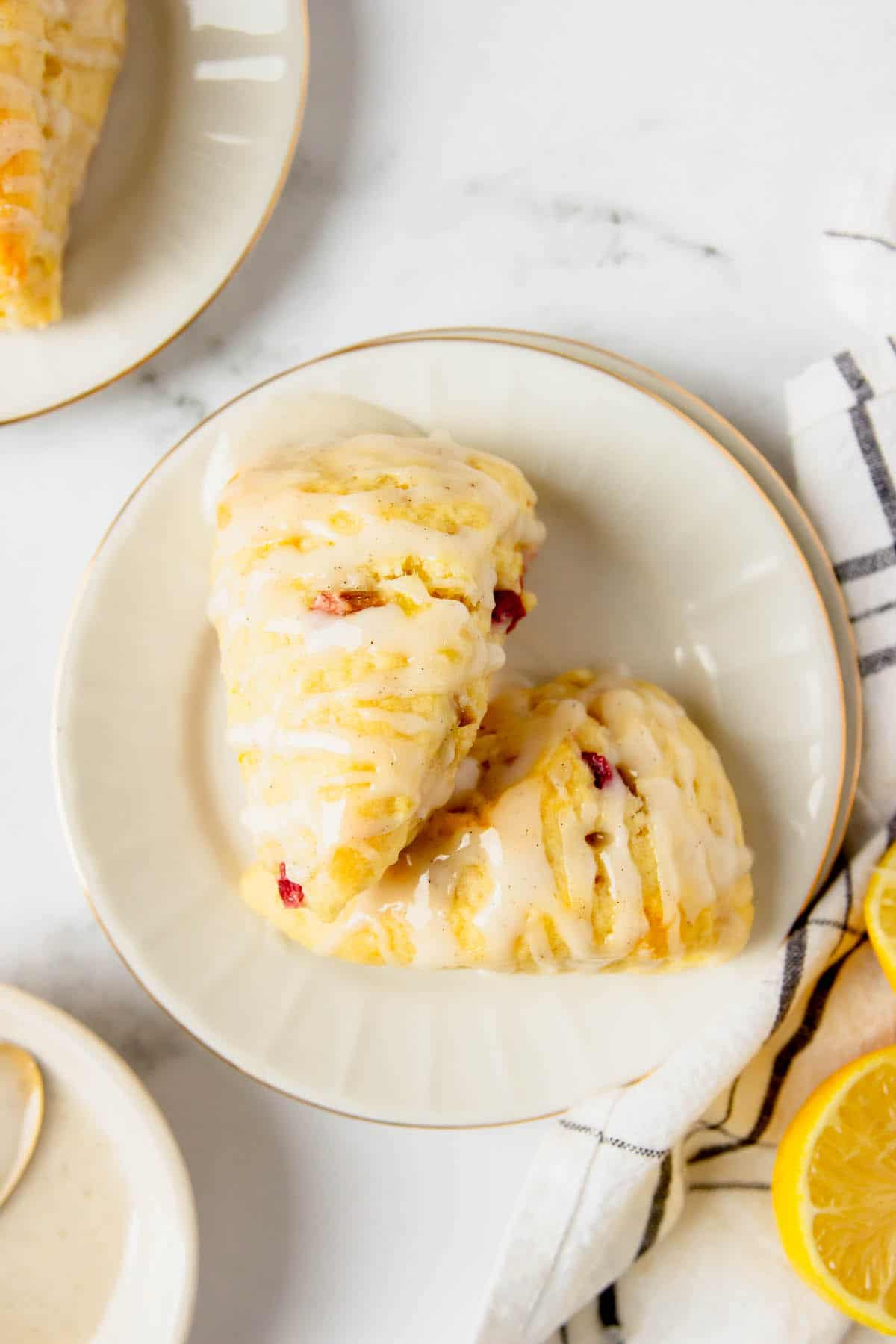 Two lemon rhubarb scones on a plate