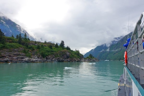 a boat traveling through Tracy Arm Fjord