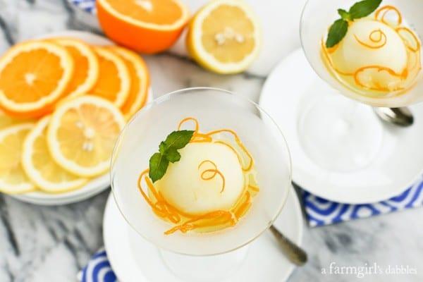 fresh orange slices on plate with glasses of Lemon Sorbet