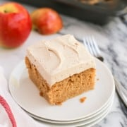 A square of Apple Cake on a plate with Brown Sugar Cinnamon Buttercream frosting