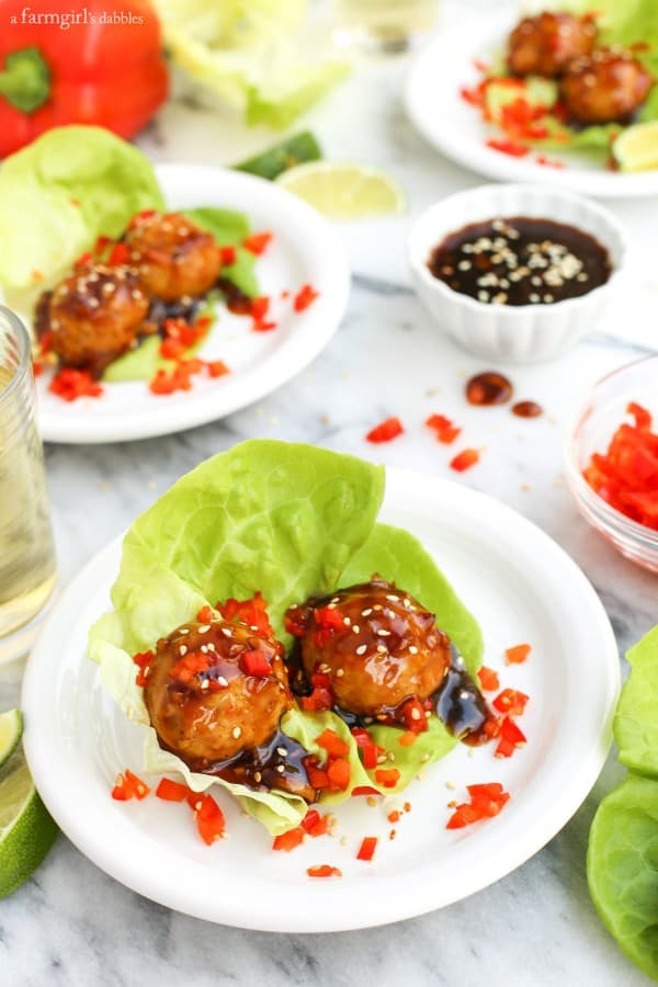 Baked Chicken Meatballs with Sweet Oyster Sauce wrapped in lettuce with red bell peppers