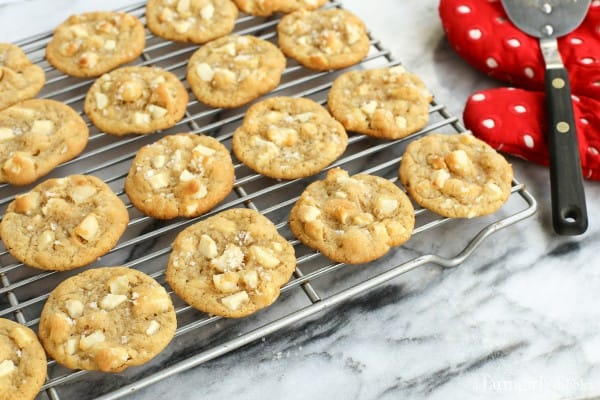 cookies on a cooling rack plus a red oven mitt