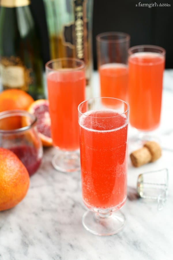 Blood Orange Mimosas in tall, skinny glasses