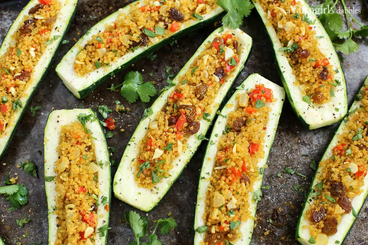 Roasted Curry Quinoa Stuffed Zucchini from afarmgirlsdabbles.com