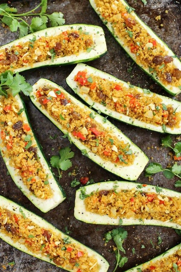 Stuffed Zucchini on a baking pan with fresh cilantro