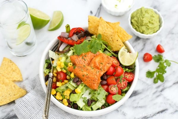 Tilapia Salad Bowl with tortilla chips and guacamole