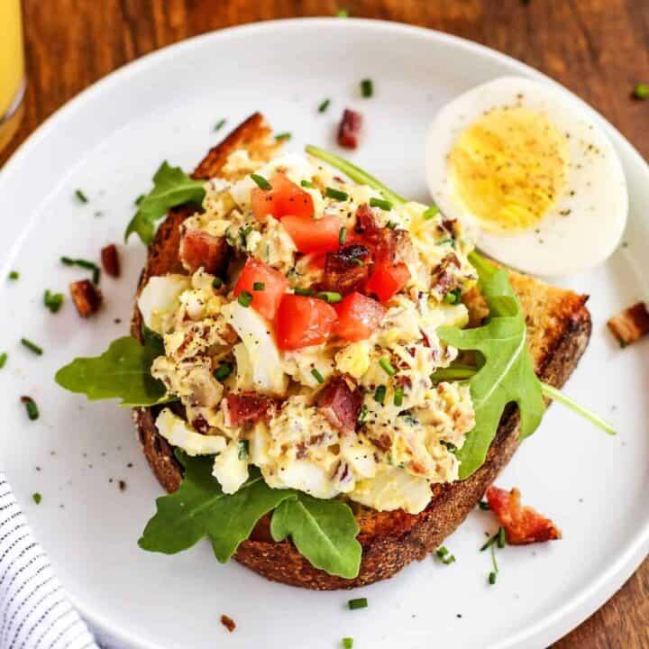 egg salad on toast, on a white plate