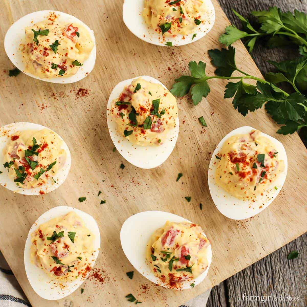Smoky Tomato Deviled Eggs from afarmgirlsdabbles.com