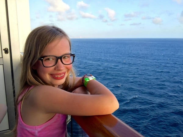 a girl on the balcony of a cruise ship