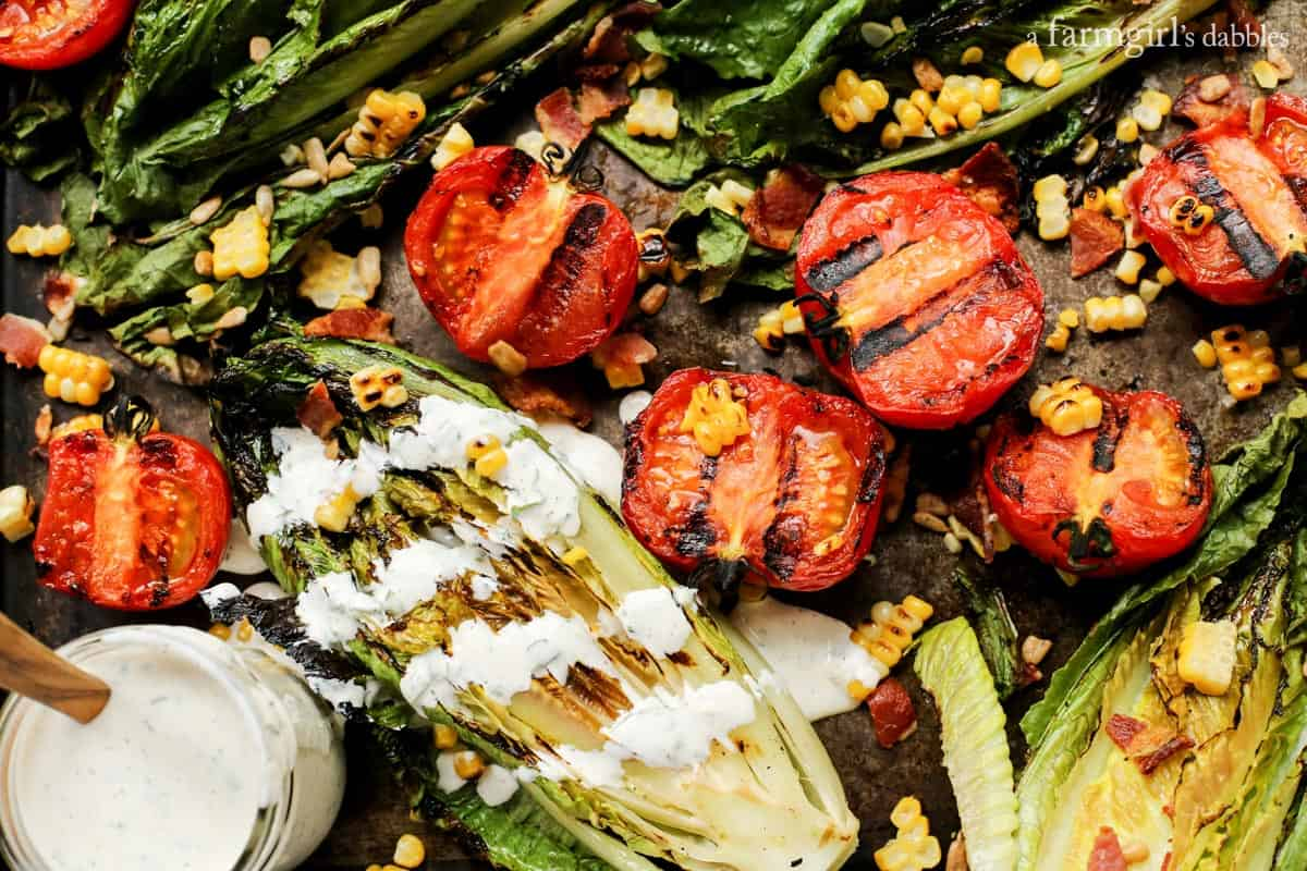 Grilled Romaine and Tomato Salad with Bacon and Homemade Buttermilk Ranch Dressing from afarmgirlsdabbles.com