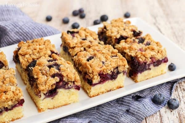 Blueberry Oat Crumble Bars with a blue striped napkin