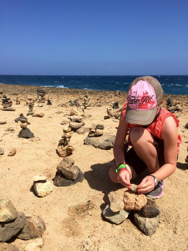 a girl stacking rocks
