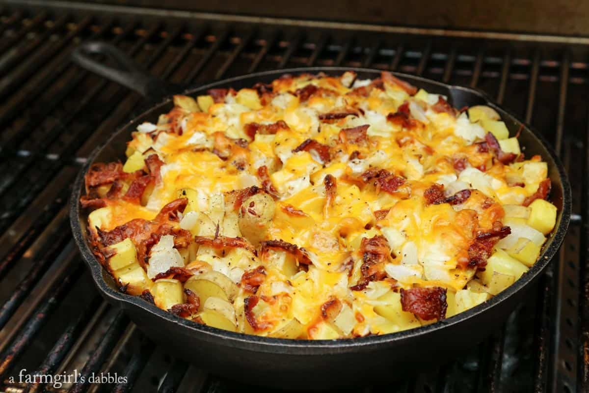 Cheesy Grilled Skillet Potatoes with Bacon and Herbs from afarmgirlsdabbles.com