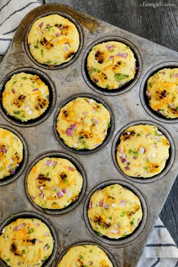 Jalapeno Grilled Sweet Corn Muffins in a muffin pan