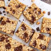 Top view of butterscotch chocolate chunk blondie squares on a sheet of parchment