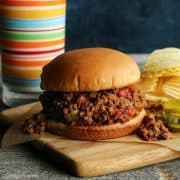 sloppy joes sandwich with potato chips and pickles