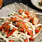 Spicy Italian Sausage Meatballs over Egg Noodles