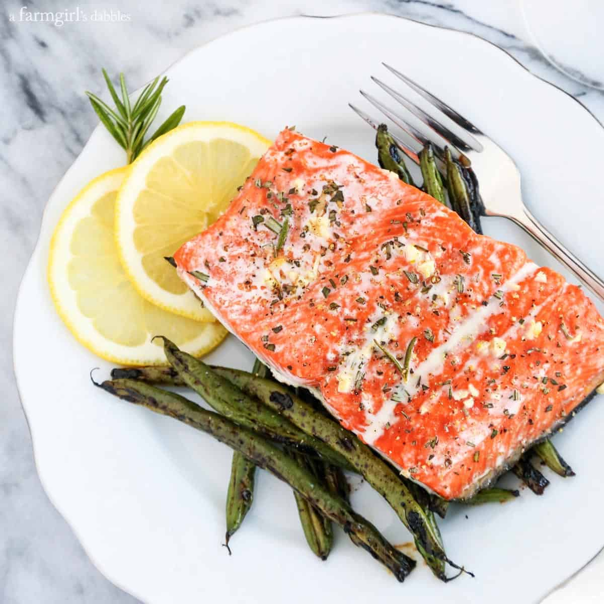 10-Minute Garlic and Rosemary Roasted Salmon from afarmgirlsdabbles.com