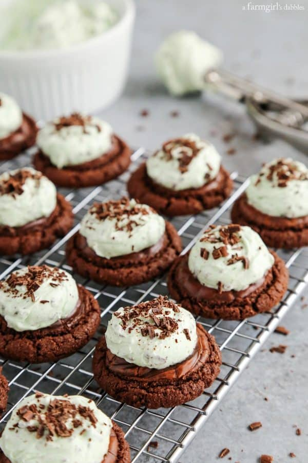 Mint Chocolate Chip Buttercream Brownie Cookies on a cooling rack