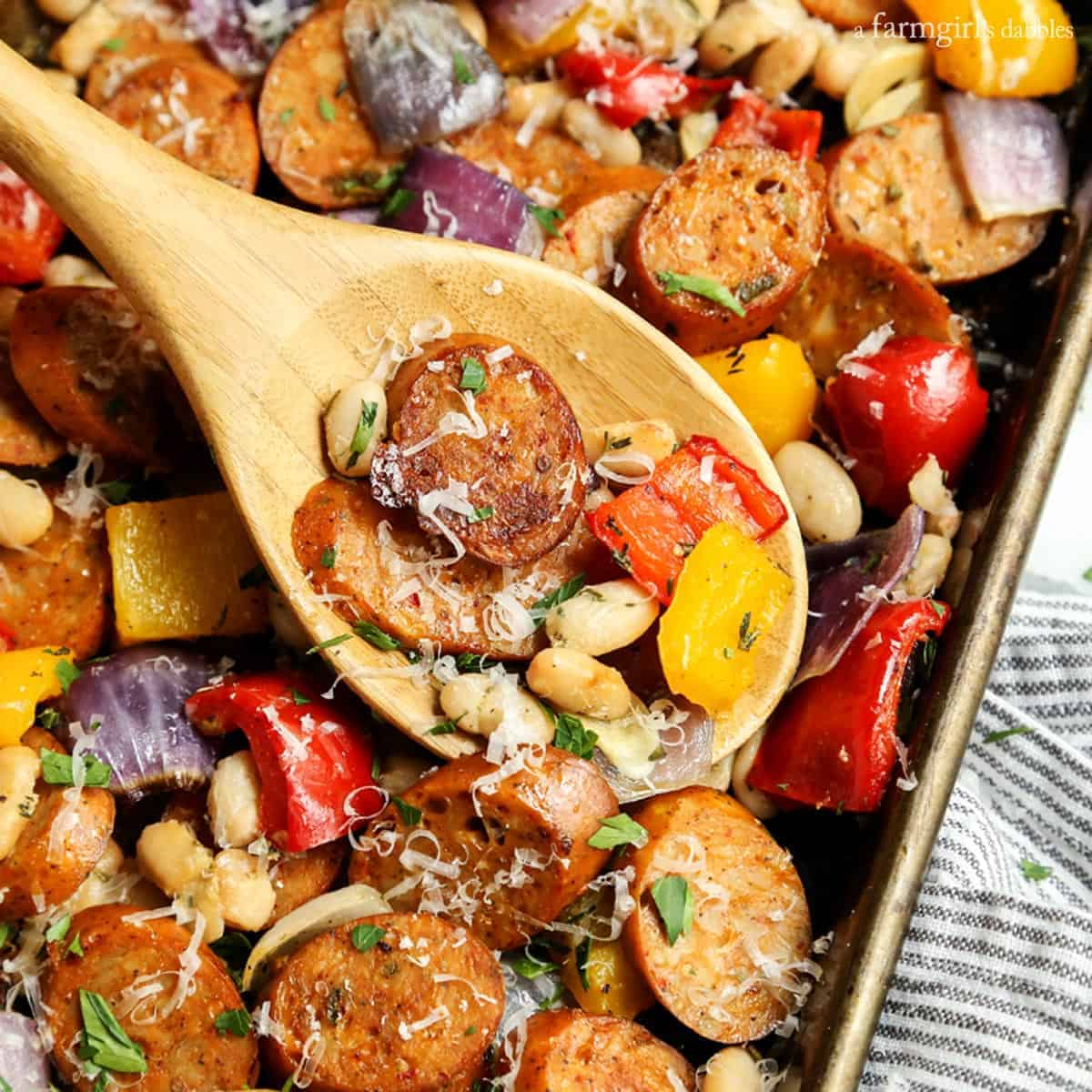 Sheet Pan Italian Chicken Sausage with White Beans and Peppers from afarmgirlsdabbles.com