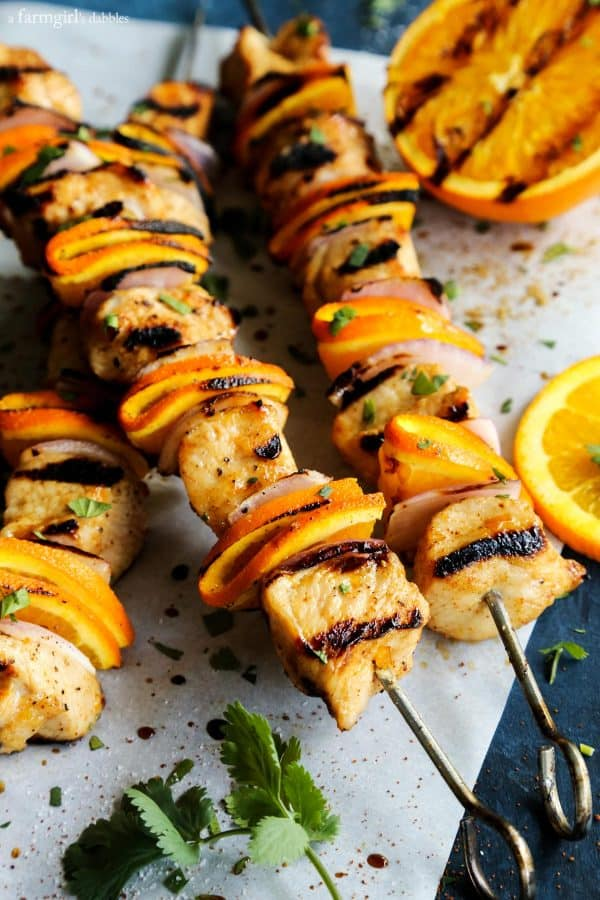 Grilled Chipotle Orange Turkey Kebabs with fresh cilantro and orange slices