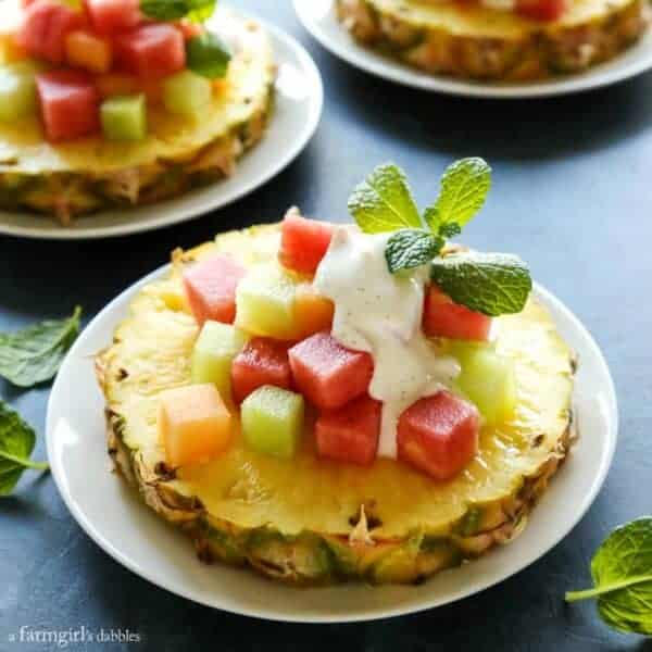 a slice of pineapple with cubes of melon on top