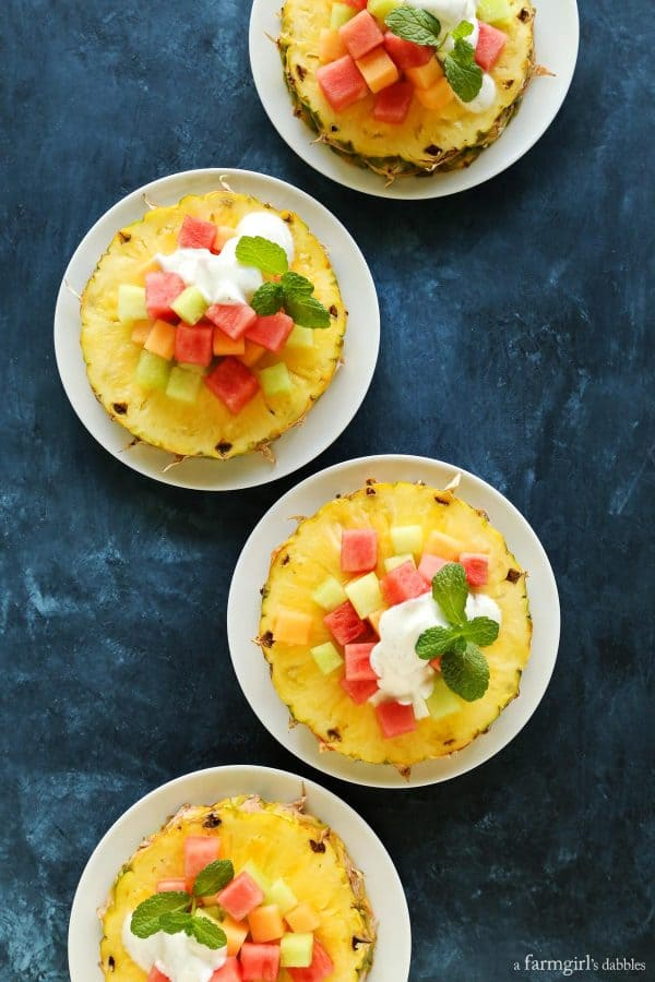 Pineapple Fruit Salad with Honey Vanilla Bean Yogurt Dressing on a blue table