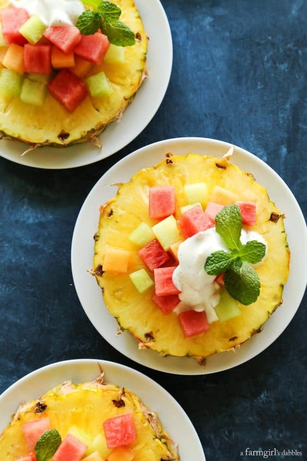 Pineapple Fruit Salad with Honey Vanilla Bean Yogurt Dressing on a white plate