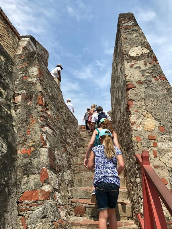 climbing the steps of Castillo de San Felipe de Barajas in Cartagena, Colombia
