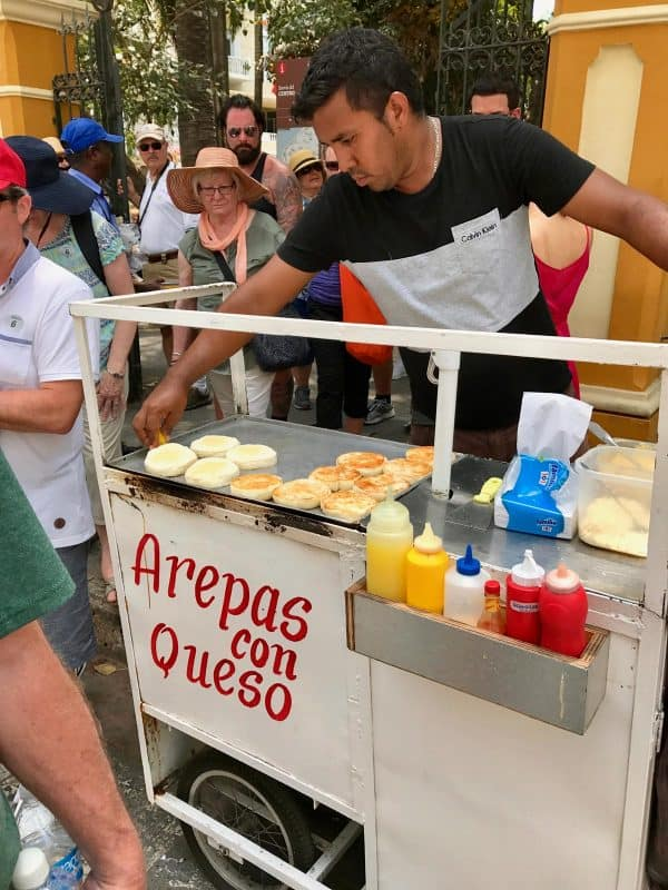 a man selling arepas con queso in Cartagena, Colombia