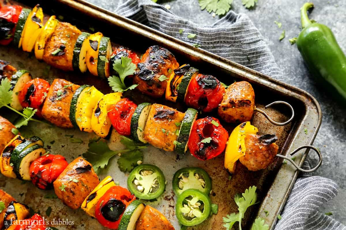 Grilled Jalapeno Cheddar Chicken Sausage Kebabs with Peppadews from afarmgirlsdabbles.com