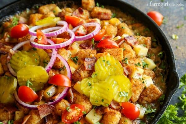 Bacon Cheeseburger Tater Tot Hotdish with sliced pickles and onions