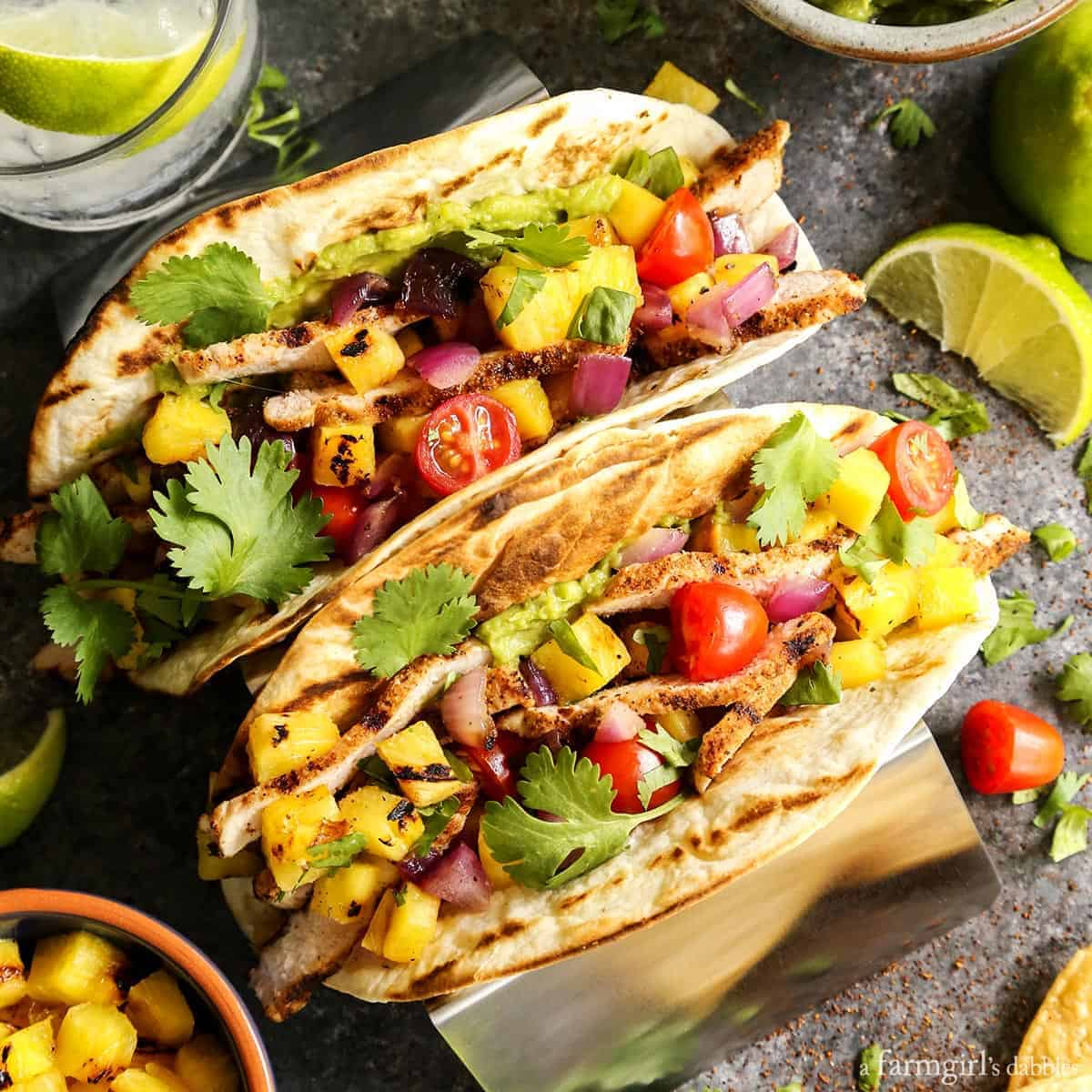 Grilled Pork and Pineapple Tacos from afarmgirlsdabbles.com