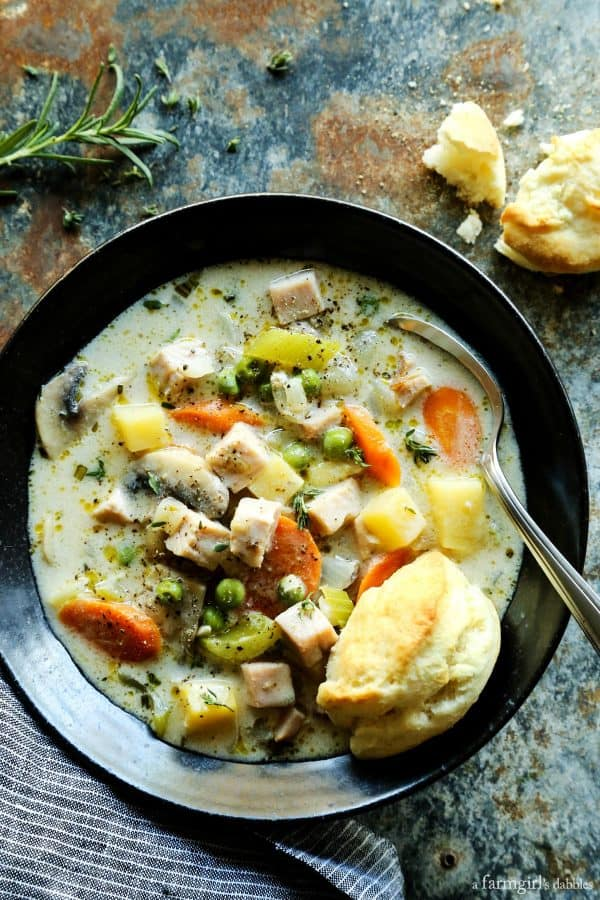 Smoked Turkey Pot Pie Soup from afarmgirlsdabbles.com - This turkey pot pie soup is is full of rich flavors and creamy comfort, and served with ultra-tender cream biscuits for dipping! #soup #turkey #turkeypotpie #biscuits