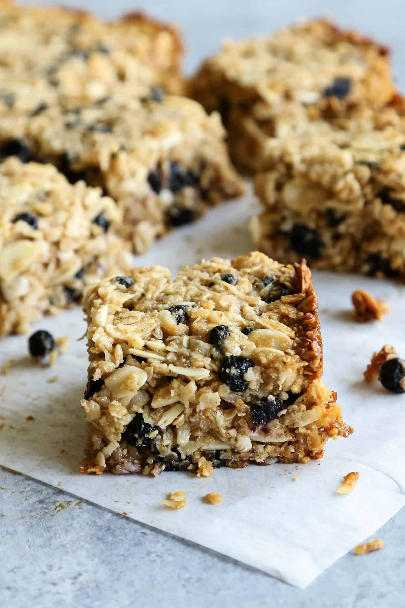 A granola square with almonds and berries
