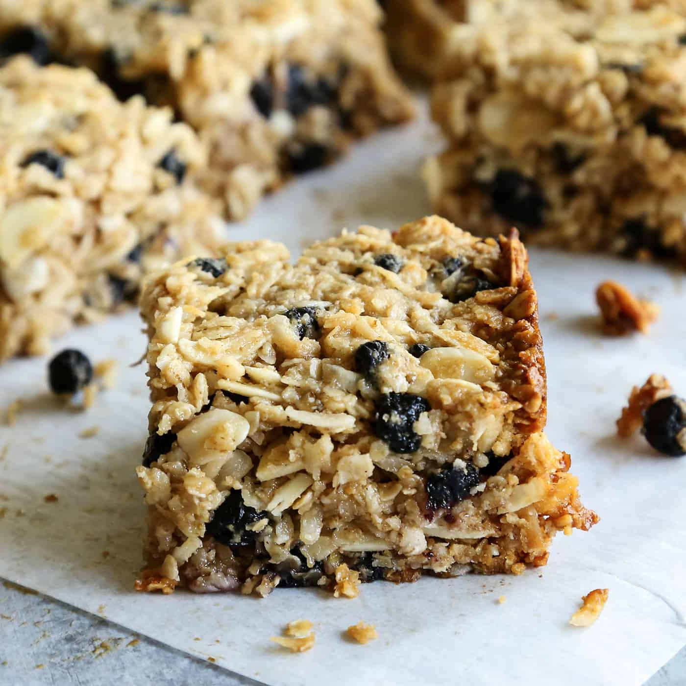 A chewy granola bar with blueberries and almonds